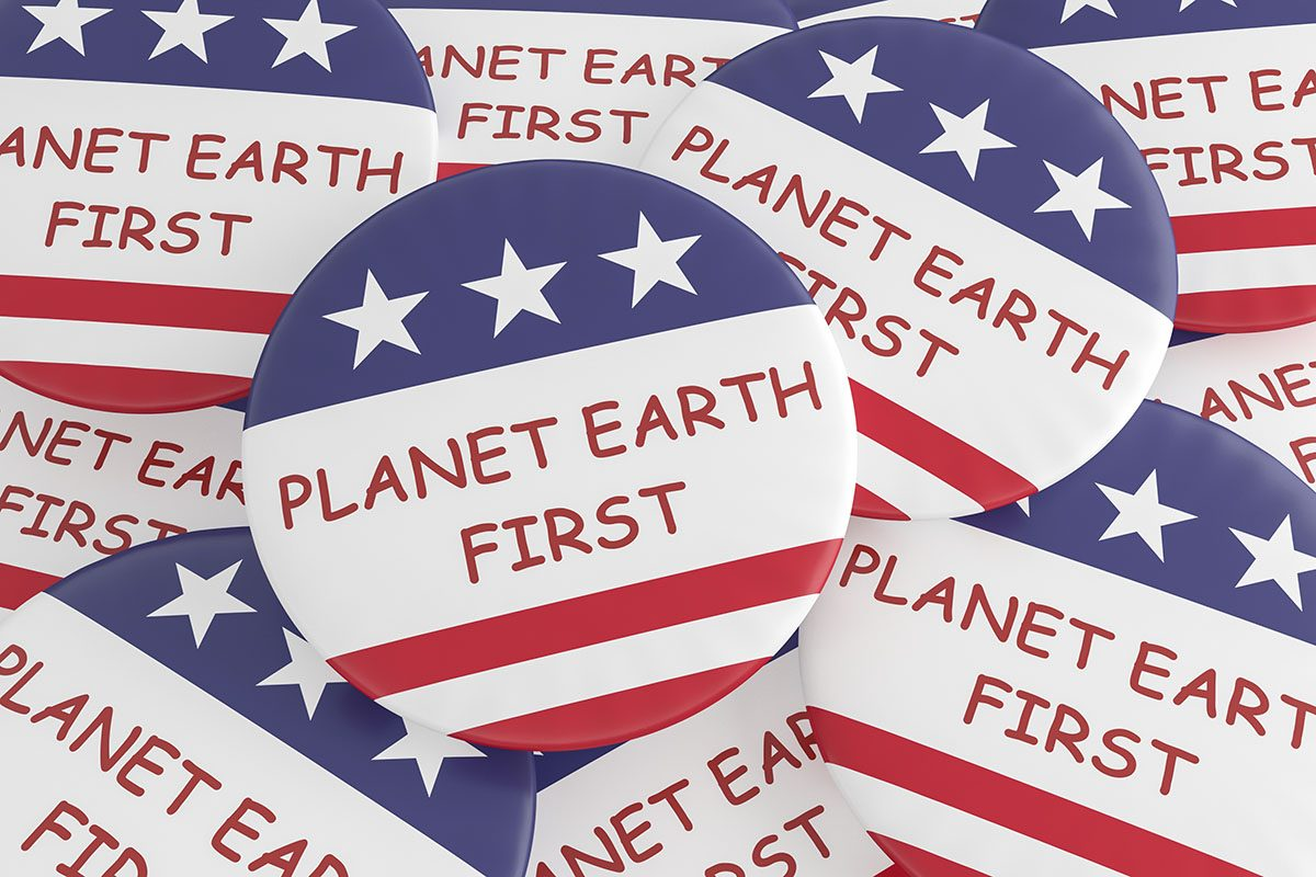 Pile of Planet Earth First Buttons with U.S. Flag Background