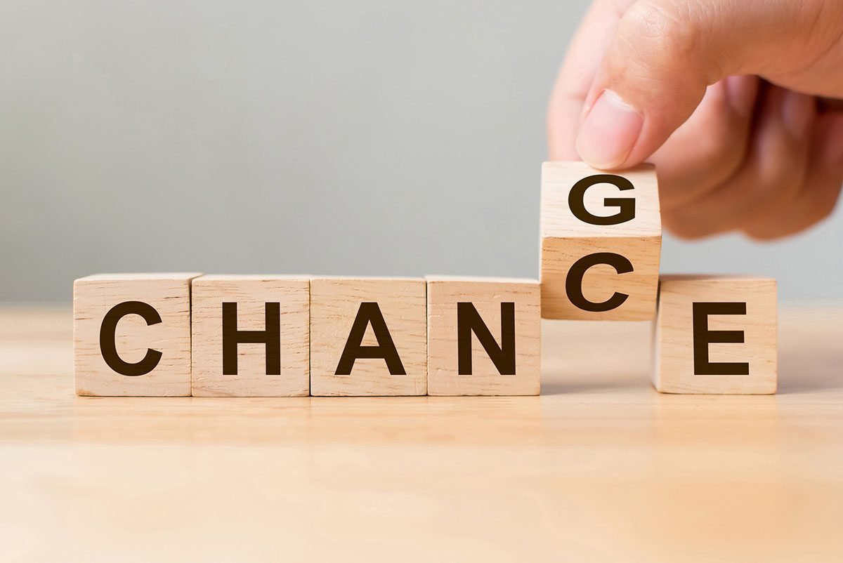 Wooden Cubes being Flipped from the Word Change to Chance