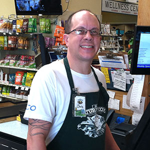 Chris Banuelos at SLO Natural Foods Co-op Checkout Counter