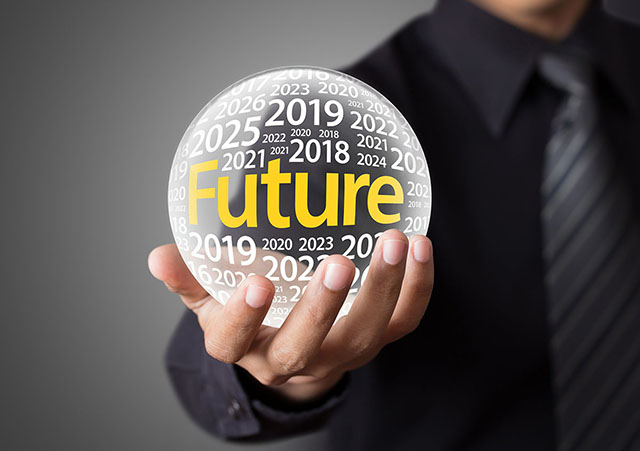 Man Holding a Crystal Ball Showing Future Years Inside