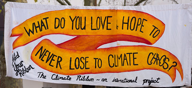 What Do Love Ribbon Banner at 2015 UN COP 21 Climate Conference in Paris, France