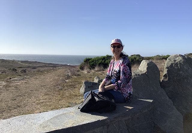 Linda Poppenheimer on Rock Bench at Fiscalini Ranch Preserve in Cambria, CA - November 2019